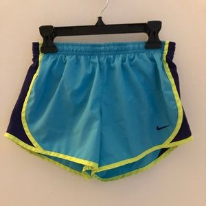 blue, yellow, and purple nike tempo shorts